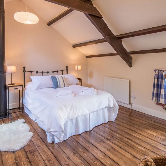 Beamed cottage bedroom