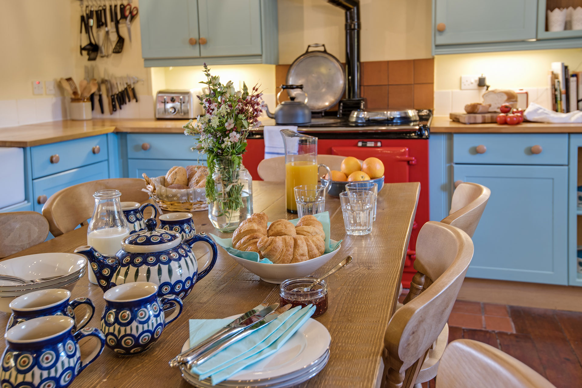 Farmhouse table set with holiday breakfast for eight