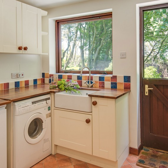 Utility room with washer and condenser dryer